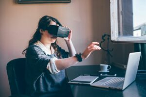 Woman learning how to get started in VR or virtual reality using her computer and VR headset